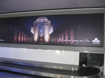 Does the War Memorial's new slogan Advance Australia Fair?