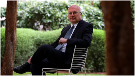 George Brandis relaxes with his friends.