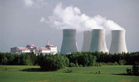 Cooling towers at a nuclear power. Nuclear energy produces vast amounts of heat that contributes to global warming.