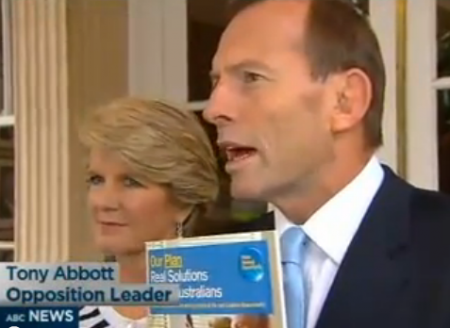 (From left) Julie Bishop, pamphlet, Tony Abbott.