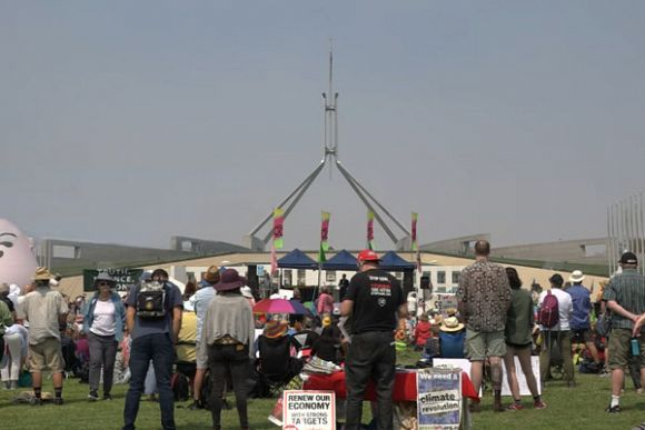Protesters circle Parliament House against climate inaction