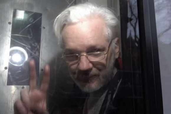 JOHN PILGER: Julian Assange's Stalinist trial mocks democracy