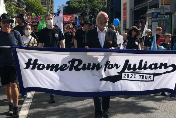 John Shipton marches for his son, Julian Assange